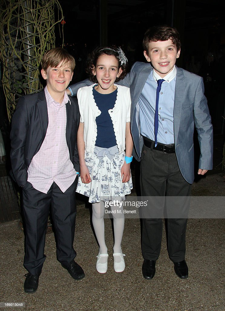 Harry Bennett, Izzy Lee and Adam Scotland pose backstage during a performance of 'To Kill A Mockingbird' at Regents Park Open Air Theatre on May 22, 2013 in London, England.