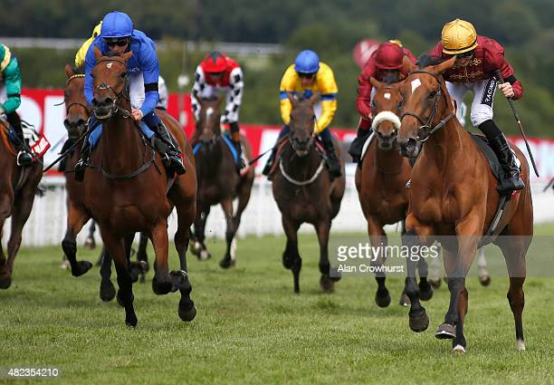 Harry Bentley punches the air after riding Simple Verse to win The Markel Insurance Fillies' Stakes at Goodwood racecourse on July 30 2015 in...