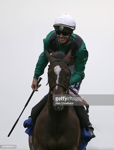 Harry Bentley riding Limato celebrates winning The Darley July Cup at Newmarket Racecourse on July 9 2016 in Newmarket England