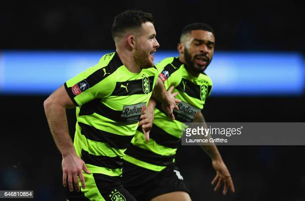 Harry Bunn of Huddersfield Town celebrates as he scores their first goal during The Emirates FA Cup Fifth Round Replay match between Manchester City...