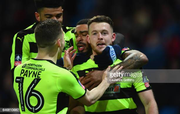 Harry Bunn of Huddersfield Town celebrates with team mates as he scores their first goal during The Emirates FA Cup Fifth Round Replay match between...