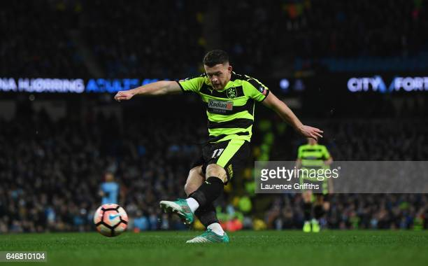 Harry Bunn of Huddersfield Town scores their first goal during The Emirates FA Cup Fifth Round Replay match between Manchester City and Huddersfield...