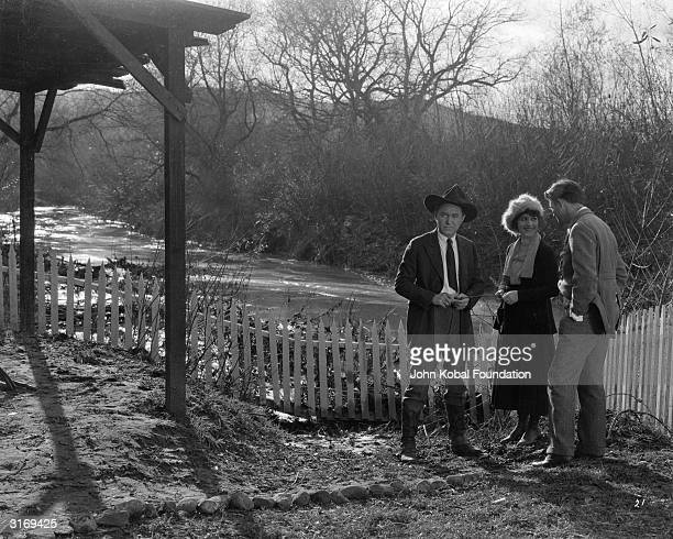 Harry Carey as Bart Carson and Irene Rich as Mrs Walker with director John Ford on the set of 'Desperate Trails'