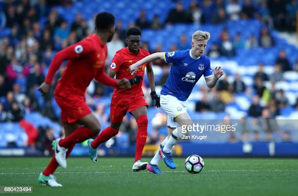 Harry Charsley of Everton controls from Ovie Ejaria and Joe Gomez of Liverpool during the Premier League 2 match between Everton and Liverpool at...
