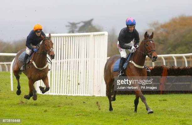 Harry Cobden and Cue Card lead Tom Scudamore and Thistlecrack in a racecourse gallop during Badger Chase Day at Wincanton Racecourse