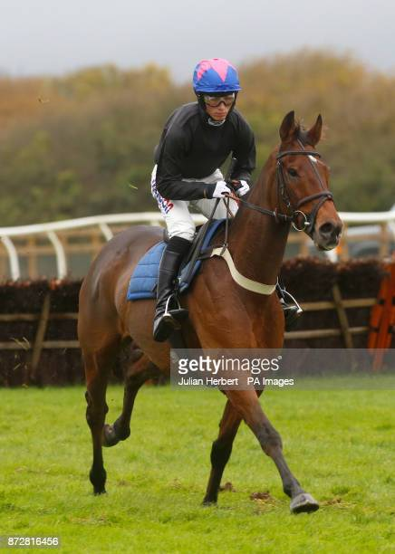 Harry Cobden and Cue Card takes part in a racecourse gallop during Badger Chase Day at Wincanton Racecourse