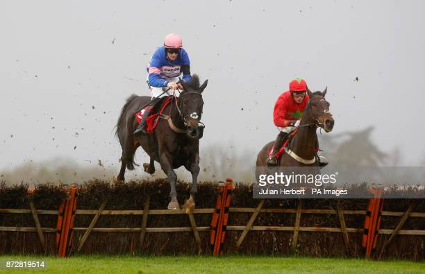 Harry Cobden and Kilbricken Storm trail Mont Des Avaloirs ridden by Sam TwistonDavies over the last flight before going on to win The EBF Stallions...