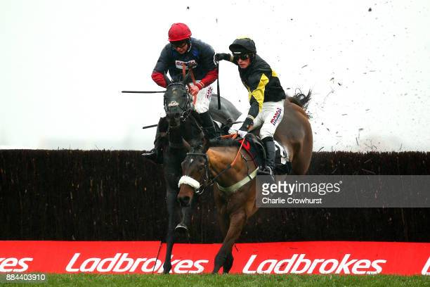 Harry Cobden jumps the last on Elegant Escape ahead of Bryony Frost on Black Cotton to win The Ladbrokes John Francome Novies' Steeple Chase as...