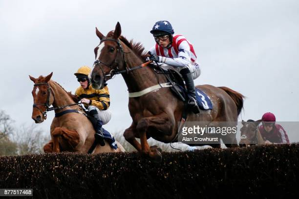 Harry Cobden riding Flaming Charmer on their way to winning The Clarion Defence Security Handicap Steeple Chase at Chepstow racecourse on November 22...