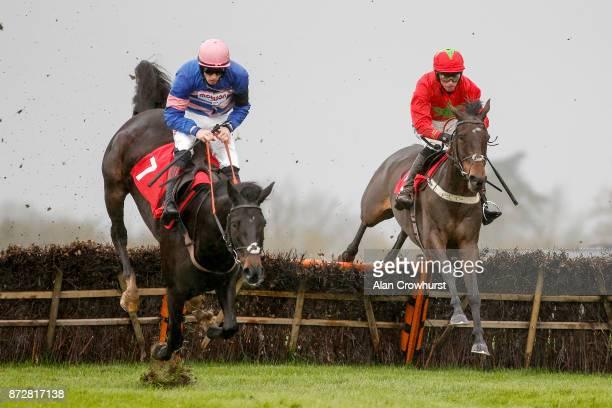 Harry Cobden riding Kilbricken Storm clear the last to win The EBF Stallions National Hunt Novices' Hurdle Race at Wincanton racecourse on November...