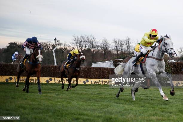 Harry Cobden riding Politologue clear the last to win The betfair Tingle Creek Steeple Chase at Sandown Park racecourse on December 9 2017 in Esher...