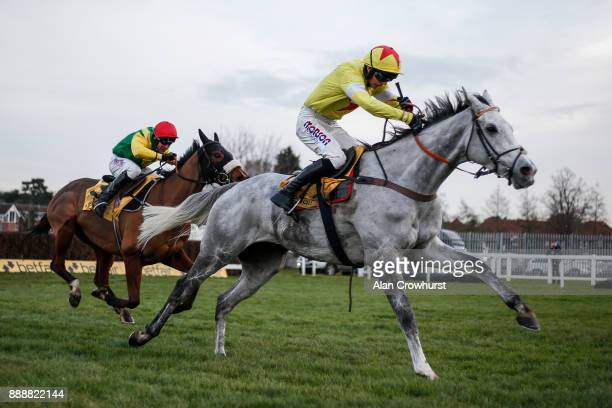 Harry Cobden riding Politologue clear the last to win The betfair Tingle Creek Steeple Chase from fox Norton at Sandown Park racecourse on December 9...