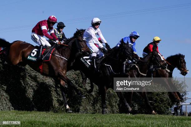 Harry Cobden riding Ultragold clear âThe Chairâ before winning The Randox Health Topham Handicap Steeple Chase at Aintree Racecourse on April 7 2017...