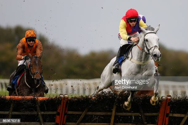 Harry Cobden riding White Moon clear the last to win The Watch Racing UK On The Go Maiden Hurdle Race at Wincanton racecourse on October 20 2017 in...