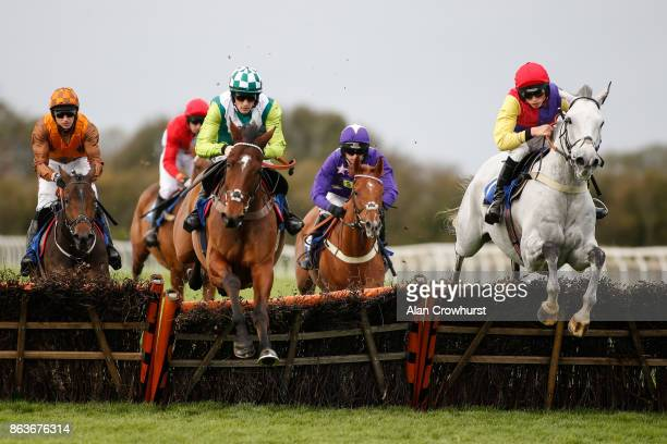 Harry Cobden riding White Moon on their way to winning The Watch Racing UK On The Go Maiden Hurdle Race at Wincanton racecourse on October 20 2017 in...