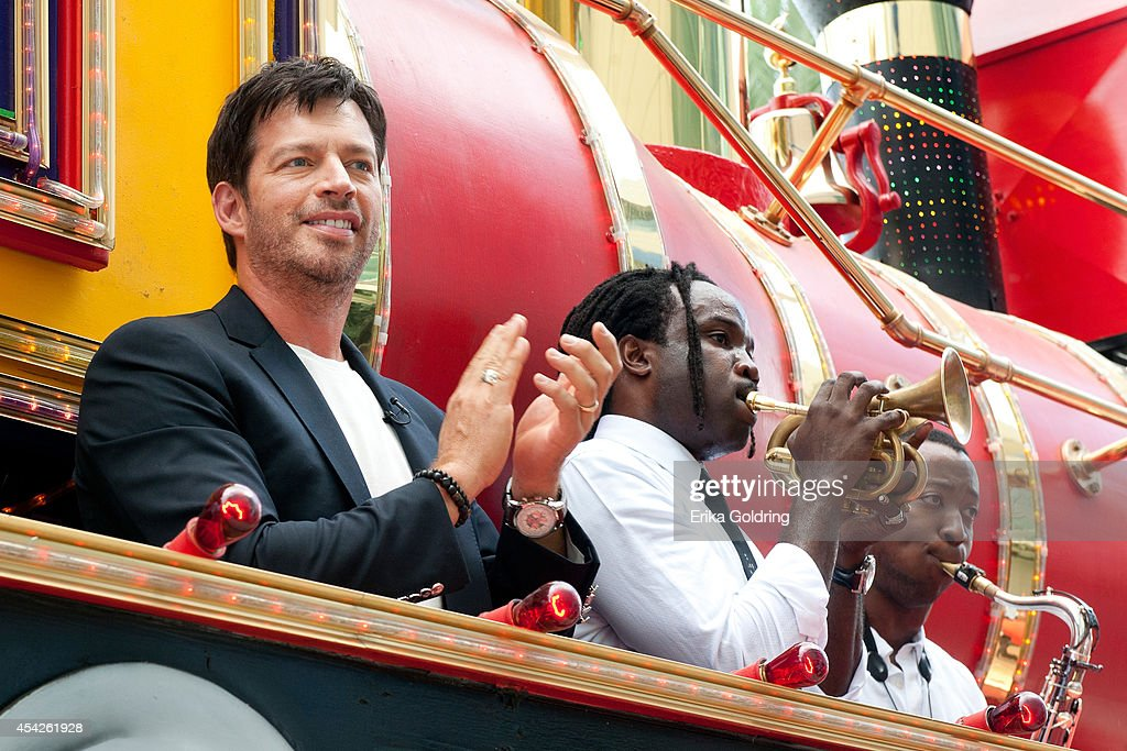 Harry Connick, Jr. and Shamarr Allen and Calvin Johnson of True Orleans Brass Band arrive at the Ernest N. Morial Convention Center on a Mardi Gras float on August 27, 2014 in New Orleans, Louisiana.