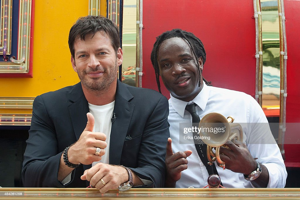 Harry Connick, Jr. and Shamarr Allen of True Orleans Brass Band arrive at the Ernest N. Morial Convention Center on a Mardi Gras float on August 27, 2014 in New Orleans, Louisiana.