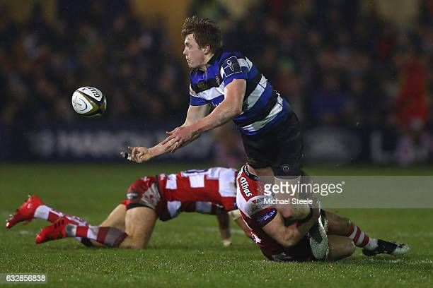 Harry Davies of Bath feeds a pass as he is tackled during the Anglo Welsh Cup match between Bath Rugby and Gloucester Rugby at the Recreation Ground...