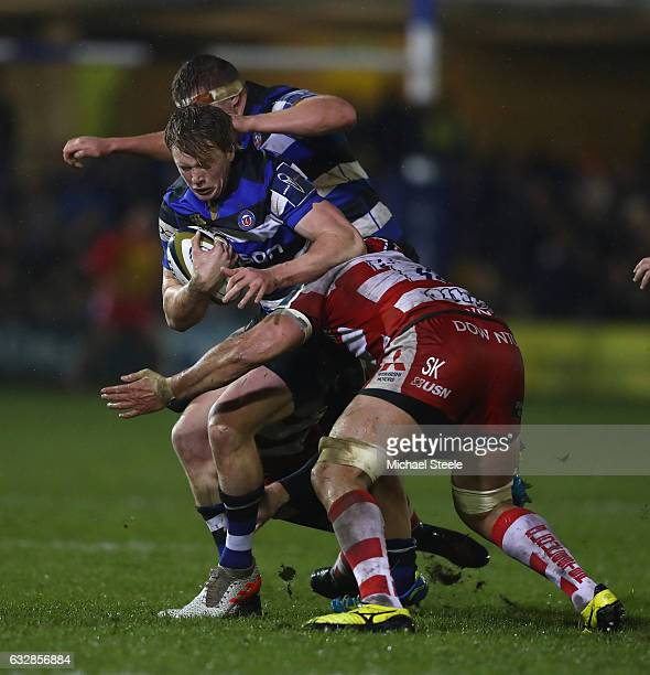 Harry Davies of Bath is tackled by Sione Kalamafoni of Gloucester during the Anglo Welsh Cup match between Bath Rugby and Gloucester Rugby at the...