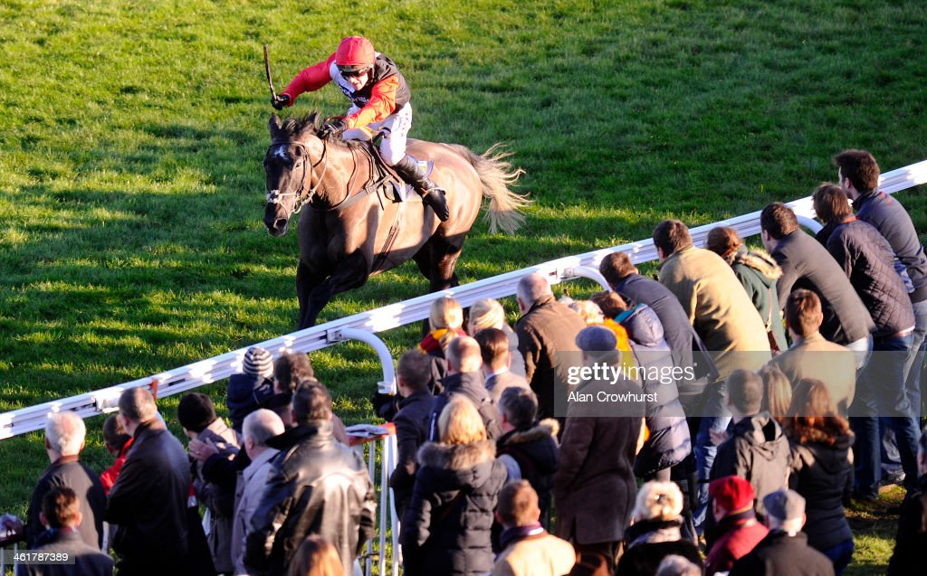 Harry Derham riding Saphir Du Rheu clear the last to win The William Hill Lanzarote Hurdle Race at Kempton Park racecourse on January 11, 2014 in Sunbury, England.