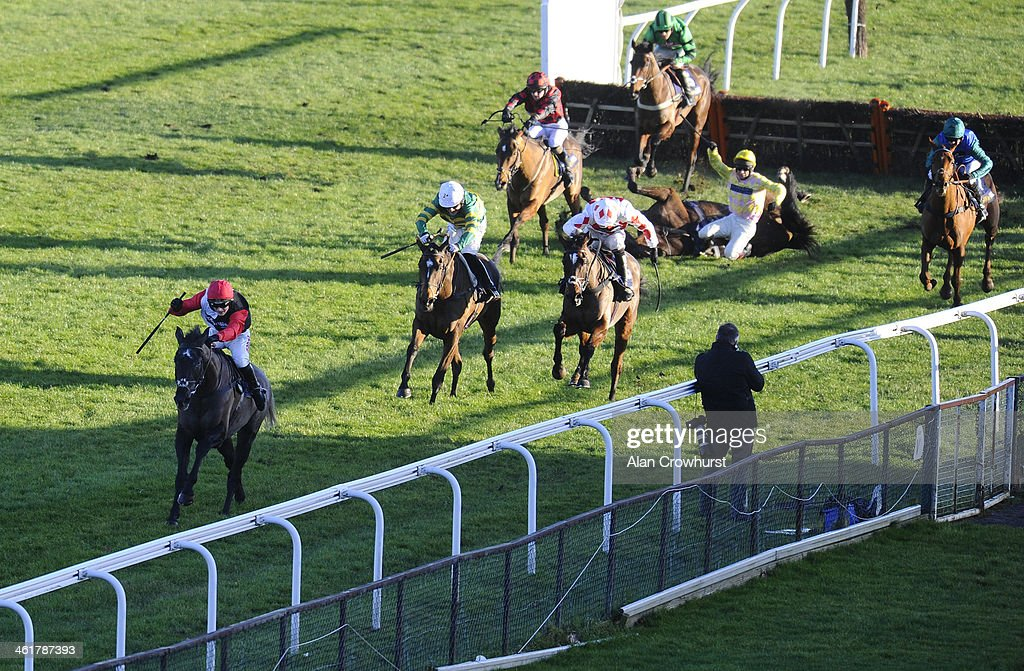 Harry Derham riding Saphir Du Rheu (L) clear the last to win The William Hill Lanzarote Hurdle Race at Kempton Park racecourse on January 11, 2014 in Sunbury, England.