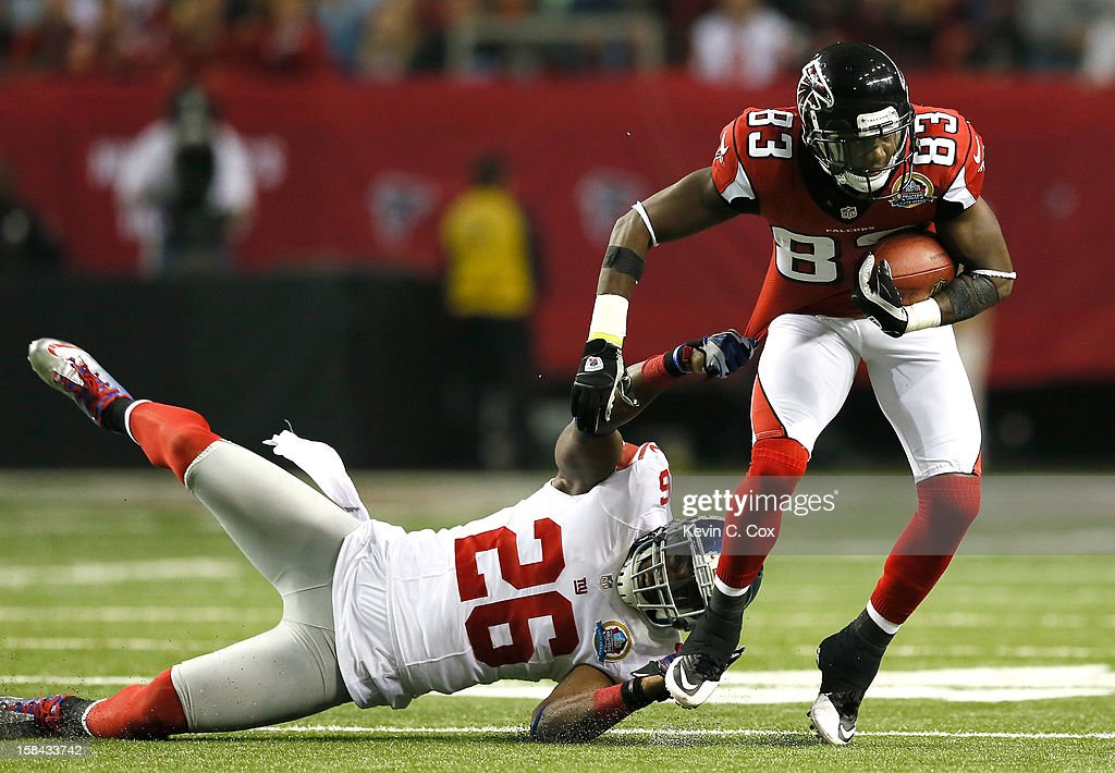 <a gi-track='captionPersonalityLinkClicked' href=/galleries/search?phrase=Harry+Douglas&family=editorial&specificpeople=2108859 ng-click='$event.stopPropagation()'>Harry Douglas</a> #83 of the Atlanta Falcons breaks a tackle against <a gi-track='captionPersonalityLinkClicked' href=/galleries/search?phrase=Antrel+Rolle&family=editorial&specificpeople=775267 ng-click='$event.stopPropagation()'>Antrel Rolle</a> #26 of the New York Giants at Georgia Dome on December 16, 2012 in Atlanta, Georgia.