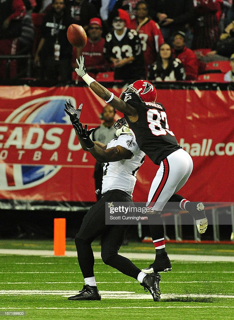 <a gi-track='captionPersonalityLinkClicked' href=/galleries/search?phrase=Harry+Douglas&family=editorial&specificpeople=2108859 ng-click='$event.stopPropagation()'>Harry Douglas</a> #83 of the Atlanta Falcons deflects a pass away from <a gi-track='captionPersonalityLinkClicked' href=/galleries/search?phrase=Malcolm+Jenkins&family=editorial&specificpeople=2726916 ng-click='$event.stopPropagation()'>Malcolm Jenkins</a> #27 of the New Orleans Saints at the Georgia Dome on November 29, 2012 in Atlanta, Georgia