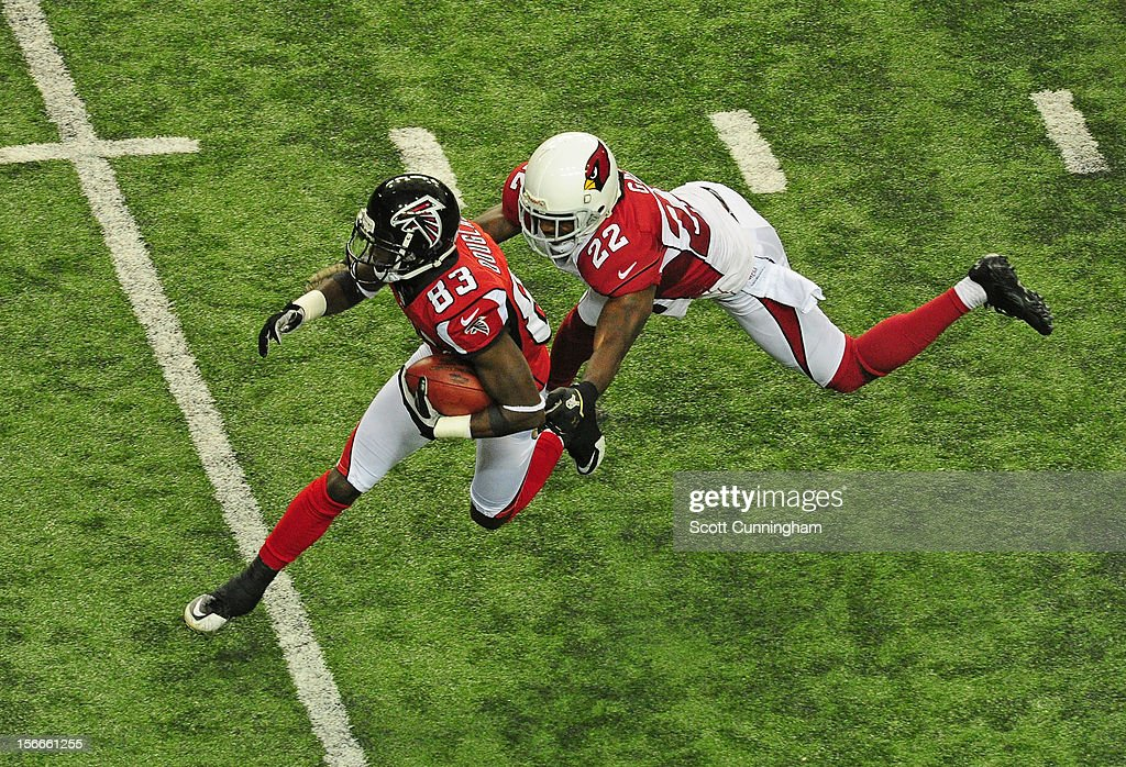 Harry Douglas #83 of the Atlanta Falcons runs with a catch against William Gay #22 of the Arizona Cardinals at the Georgia Dome on November 18, 2012 in Atlanta, Georgia