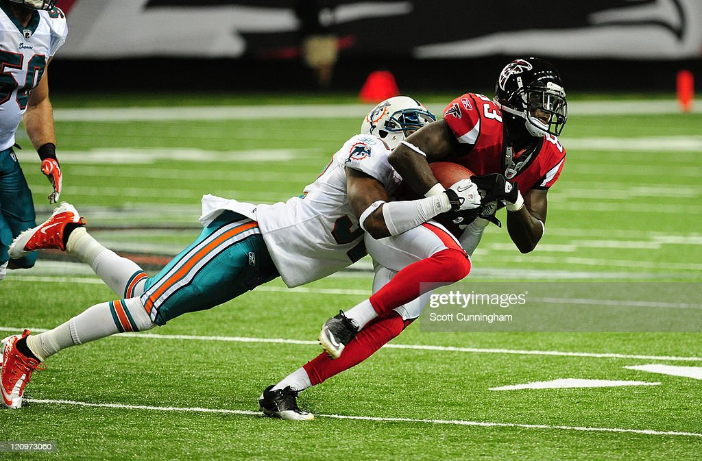 <a gi-track='captionPersonalityLinkClicked' href=/galleries/search?phrase=Harry+Douglas&family=editorial&specificpeople=2108859 ng-click='$event.stopPropagation()'>Harry Douglas</a> #83 of the Atlanta Falcons runs with a catch against Nate Ness #32 of the Miami Dolphins during a preseason game at the Georgia Dome on August 12, 2011 in Atlanta, Georgia.