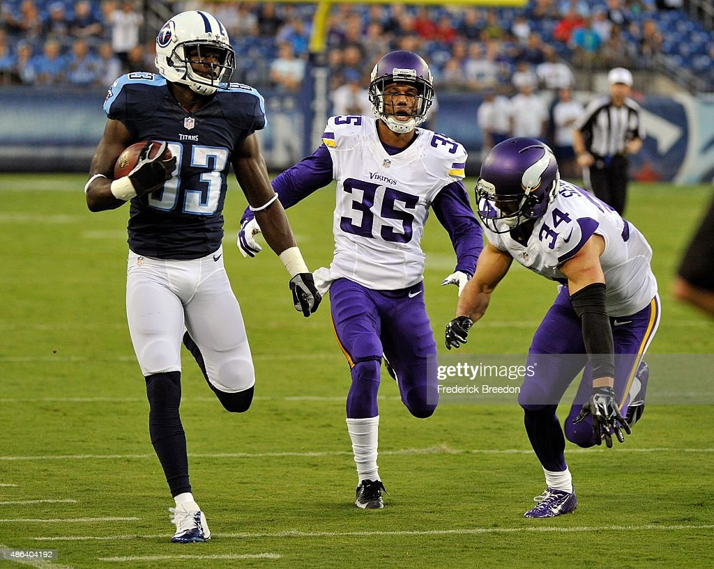 Harry Douglas of the Tennessee Titans runs past Marcus Sherels and Andrew Sendejo of the Minnesota Vikings for a touchdown during the first half of a...