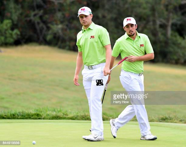 Harry Ellis and Alfie Plant of Team Great Britain and Ireland line up a putt on the third green losing eight and seven to Norman Xiong and Collin...