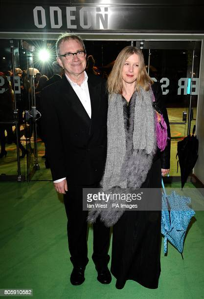 Harry Enfield and his wife Lucy arriving for the Royal world premiere of Alice in Wonderland at the Odeon Leicester Square London