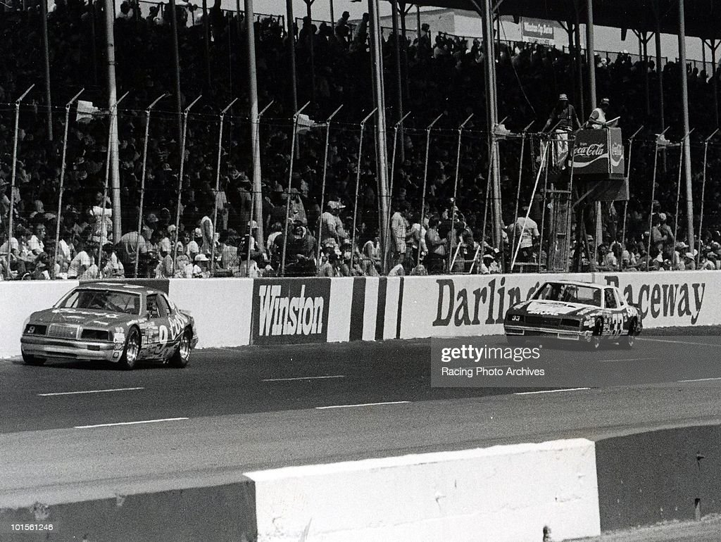 Harry Gant trys to keep up with Bill Elliottt on the final lap of the TranSouth 500. Elliott would finish first and take home $42,900 for the victory.