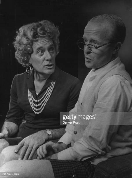 Harry Geldard masquerading as a woman and Ralph Dowling as Mr Mole are pictured in a scene from 'Love's a Luxury' a farce which is the current...