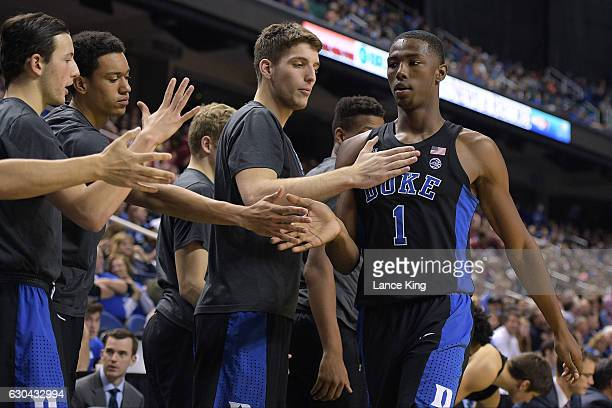 Harry Giles of the Duke Blue Devils shakes hands with teammates Brennan Besser Justin Robinson and Antonio Vrankovic during their game against the...