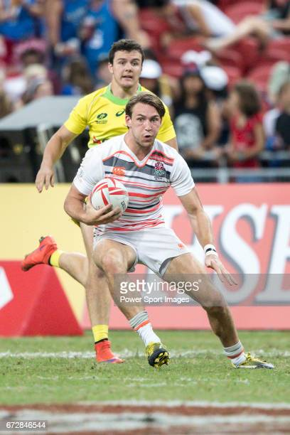 Harry Glover of England runs with the ball during the match Australia vs England the Bronze Final of Day 2 of the HSBC Singapore Rugby Sevens as part...