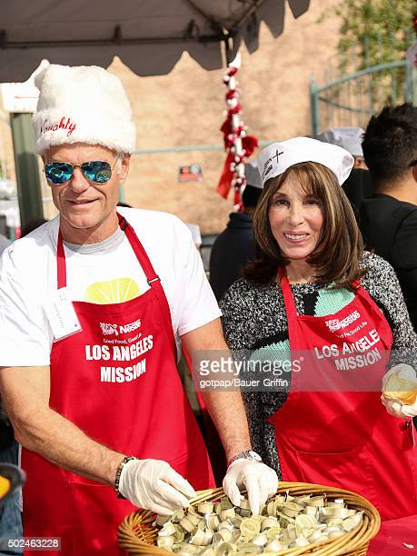 Harry Hamlin and Kate Linder are seen at the annual Los Angeles Mission Christmas Dinner on December 24 2015 in Los Angeles California
