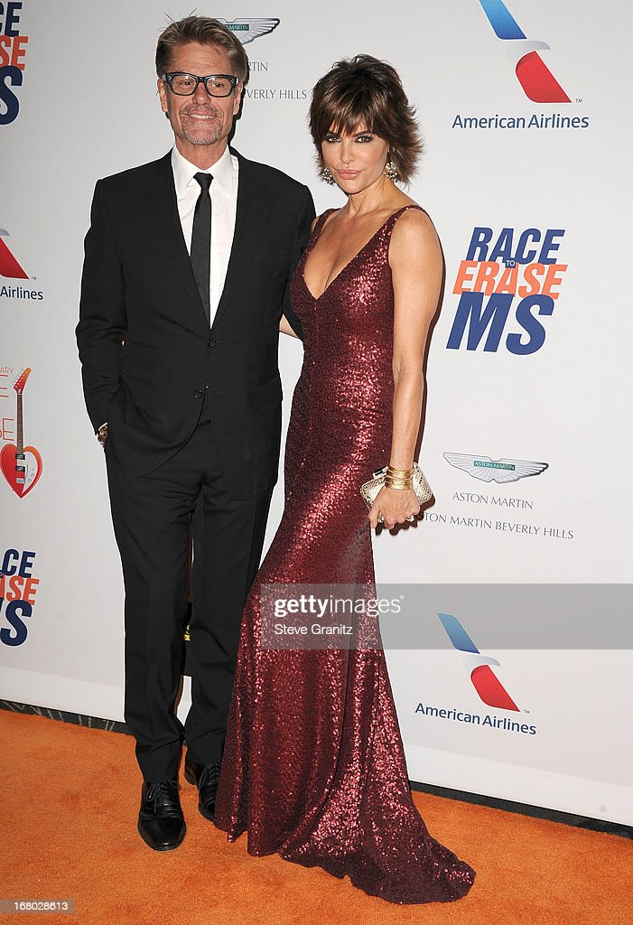 Harry Hamlin and Lisa Rinna arrives at the 20th Annual Race To Erase MS Gala 'Love To Erase MS' at the Hyatt Regency Century Plaza on May 3, 2013 in Century City, California.