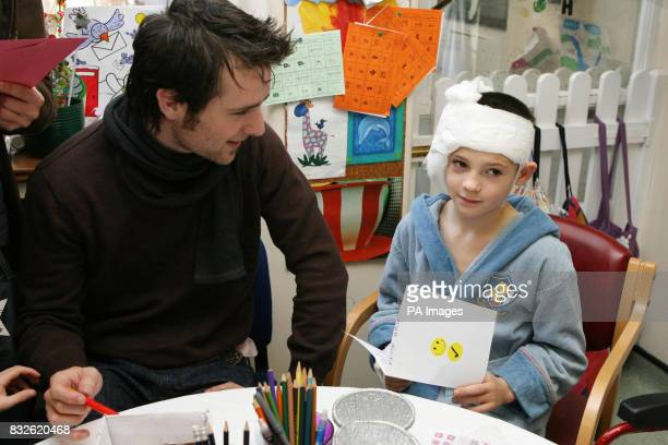 Harry Judd from the pop band McFly designs a Christmas card with Elliott Hales age 9 from Milton Keynes as he visits Great Ormond Street Children's...