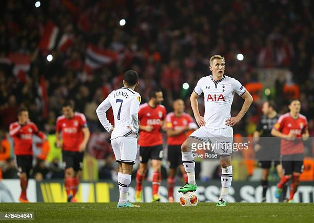 Harry Kane and Aaron Lennon of Tottenham Hotspur look dejected as Luisao of Benfica scores their second goal during the UEFA Europa League Round of...