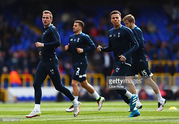 Harry Kane and Dele Alli of Tottenham Hotspur warm up prior to the Barclays Premier League match between Tottenham Hotspur and Manchester United at...