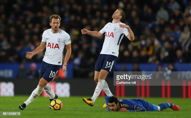 Harry Kane and Eric Dier of Tottenham Hotspur react as Vicente Iborra of Leicester City lies on the pitch during the Premier League match between...