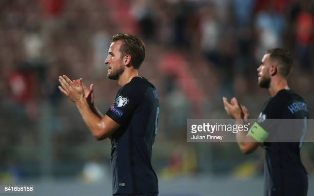 Harry Kane and Jordan Henderson of England applaud the travelling fans after the FIFA 2018 World Cup Qualifier between Malta and England at Ta'Qali...