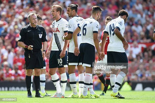 Harry Kane and Nacer Chadli line up in the wall during the Barclays Premier League match between Manchester United and and Tottingham Hotspur at Old...
