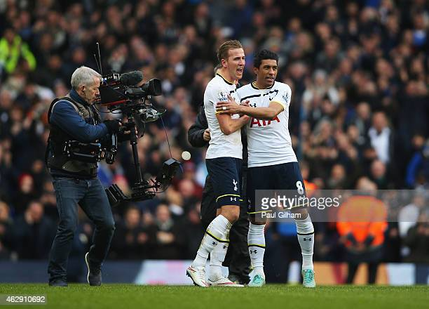 Harry Kane and Paulinho of Tottenham Hotspur celebrate victory after the Barclays Premier League match between Tottenham Hotspur and Arsenal at White...