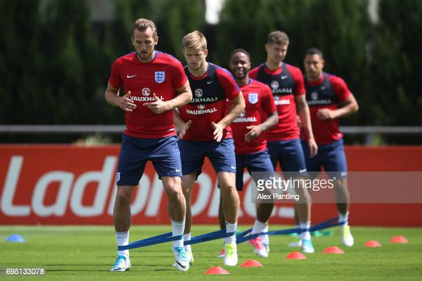 Harry Kane and teammates run through drills during the England training session at the Chemin De Ronde Stadium on June 12 2017 in CroissysurSeine...