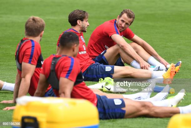 Harry Kane chats with Adam Lallana during the England training session at the Chemin De Ronde Stadium on June 12 2017 in CroissysurSeine France