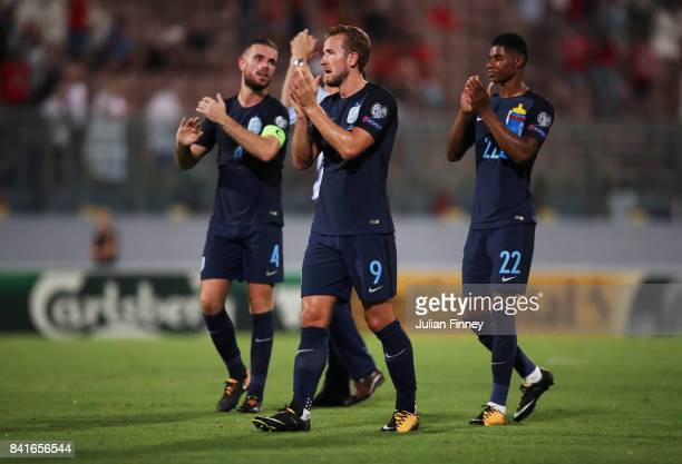 Harry Kane Jordan Henderson and Marcus Rashford of England applaud the travelling fans after the FIFA 2018 World Cup Qualifier between Malta and...