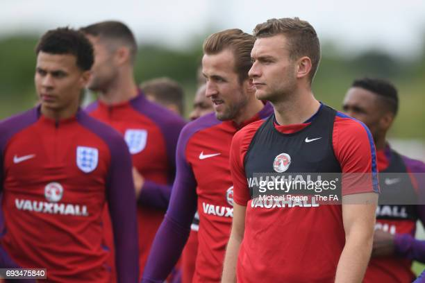 Harry Kane looks on with Ben Gibson at St Georges Park on June 7 2017 in BurtonuponTrent England