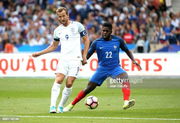 Harry Kane of England and Samuel Umtiti of France during the international friendly match between France and England at Stade de France on June 13...